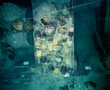 Section of the hull of the Santa Cruz junk. The foremost compartment has been already excavated and can be seen empty; the middle one is still untouched; the one in the background is under excavation.