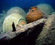 A jar from Vietnam and celadon bowls from the kilns of Longquan discovered on the wreck of the Santa Cruz.
