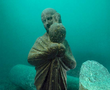 The statue of an Isis priest holding an Osiris-Canopus found on the sunken Island of Antirhodos in the great harbour of Alexandria. The statue from black granite is 1.22 meters high.