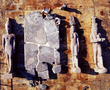 Aerial view of the colossal triad of 5-metre high red granite statues of a pharaoh, his queen and the god Hapy, dating from the 4th century BC, which stood in front of the great temple of Heracleion. They are placed on a pontoon barge together with the 17 fragments of an over 5-metre high 2nd century BC red granite stele in reassembly; the workers on the pontoon provide a notion of the dimensions of these objects.